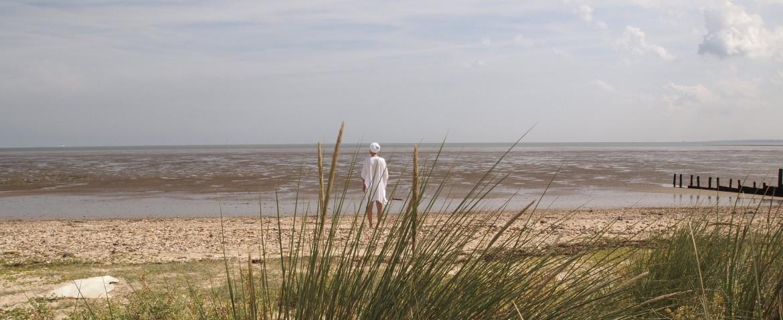 Kundalini yogi facing the sea